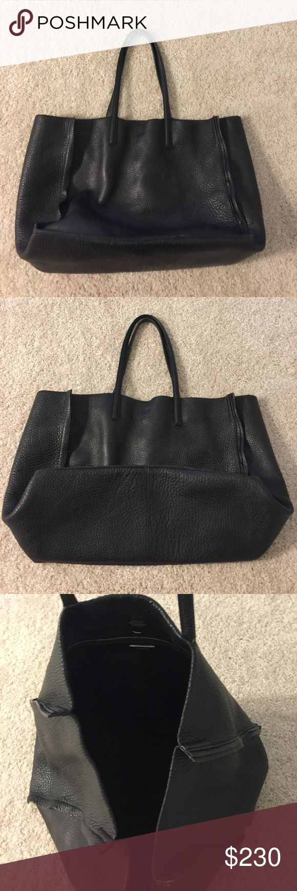 Aritzia auxiliary tote Black pebbled leather. Only used a few times. Wear on the handles (the price reduction reflects this). Aritzia Bags Totes