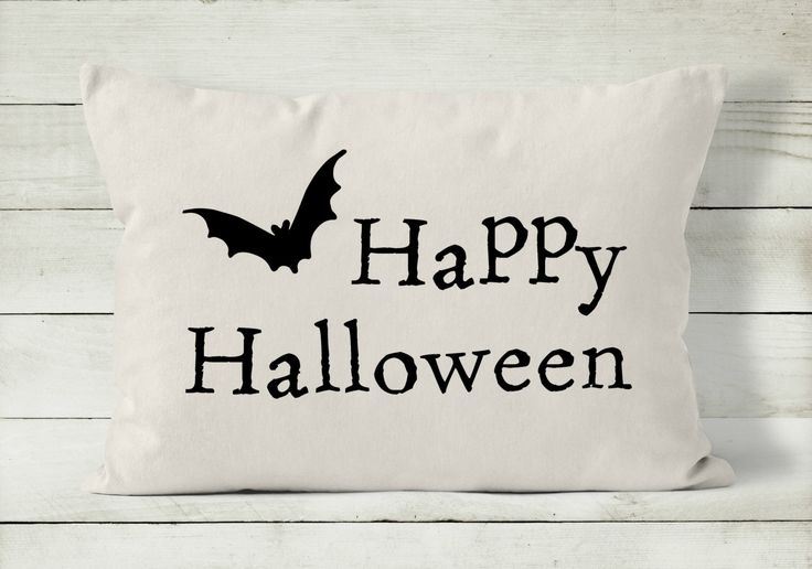 """Decorative throw pillow covers are a quick and easy way to decorate your home for holidays. Change your pillow cover and you have a whole new look! This 12 x 16 quote pillow reads """"Happy Halloween"""" and features a cute flying bat. Handmade with natural cotton, it is perfectly neutral to complement any decor. • Sized to fit a 12 x 16 inch pillow form. Actual size of cover is slightly smaller to insure a snug fit and plump pillow.  • Pillow insert is not included.  • Please see Frequently…"""