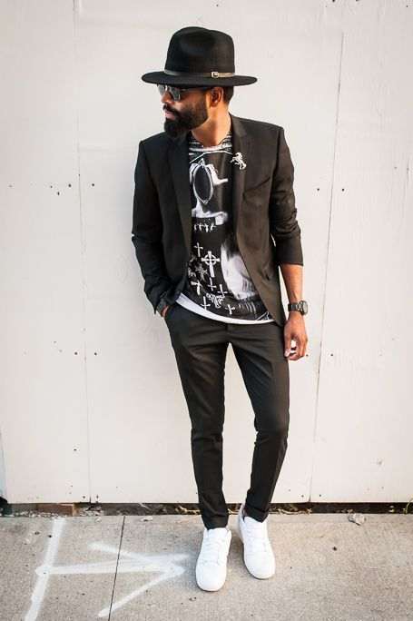 Shop this look on Lookastic:  http://lookastic.com/men/looks/hat-sunglasses-blazer-crew-neck-t-shirt-watch-dress-pants-low-top-sneakers/6282  — Black Wool Hat  — Black Sunglasses  — Black Blazer  — Black and White Print Crew-neck T-shirt  — Black Watch  — Black Dress Pants  — White Low Top Sneakers