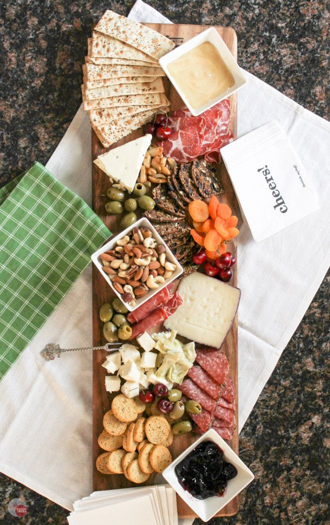 The perfect summer appetizer is an antipasto cheese board. Full of fruits, meats, cheeses, nuts, and olives it is perfect for satisfying all your guests at the same time! Summer Tapas Antipasto Cheese Board Recipe | Take Two Tapas