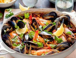 Learn the secrets to a perfect seafood and chorizo paella as Karen Martini cooks up a Spanish feast.