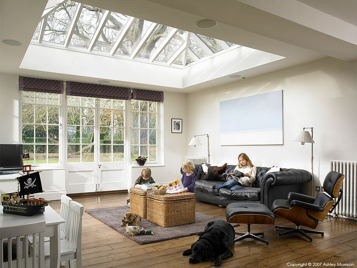 The kitchen conservatory area of Coral & Rob Garlick's Edwardian mansion located near Godalming in Surrey by Ashley Morrison.