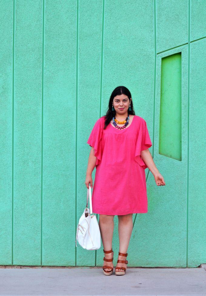 Pink plus size dress worn by blogger Jay Miranda