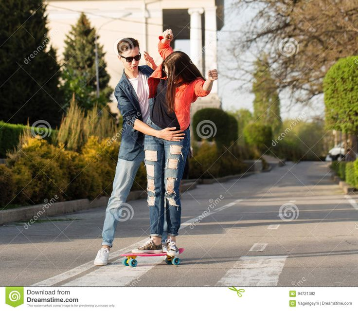 Man Learns Girlfriend To Skateboard - Download From Over 61 Million High Quality Stock Photos, Images, Vectors. Sign up for FREE today. Image: 94721392