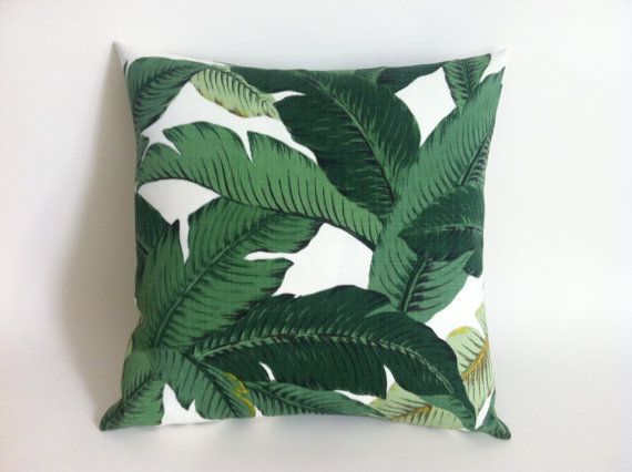 One Tropical green decorative throw pillow cover in Lush Beverly Hills Banana leaves print. Colors include shades of true green on an ivory…