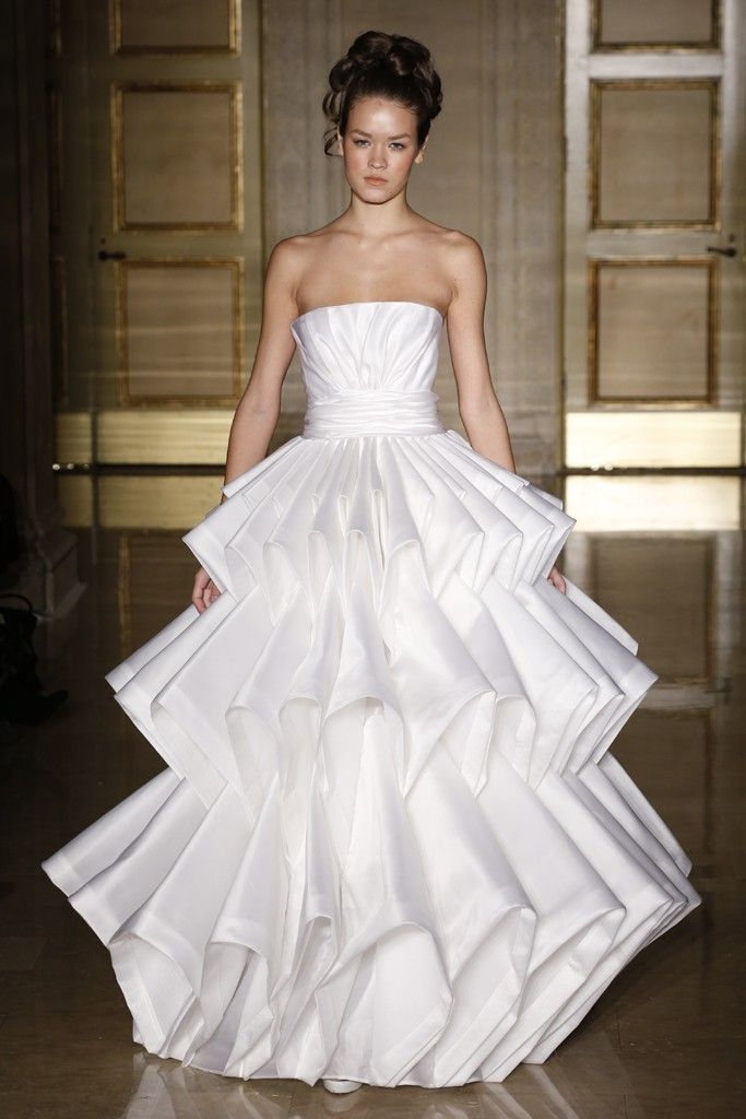 15 Attention-Grabbing Gowns from the Fall 2013 Bridal Shows: Douglas Hannant: This one takes some chutzpah. For the bride not afraid of volume--or looking like a coffee filter.