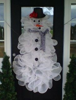 Deco Mesh Snowman with 3 connected wreaths!  Great inspiration for the holidays!  Get fabulous deco mesh from Old Time Pottery today!  http://www.oldtimepottery.com/
