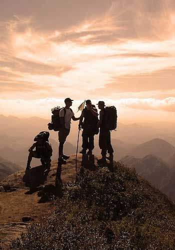 hiking with friends to the top of a mountain
