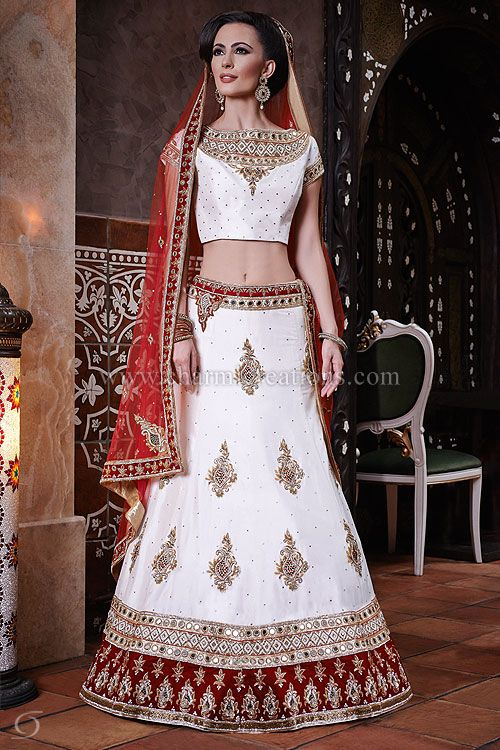 Indian Bridal Dresses - 8 panel traditional mirror work white silk lengha with a red net dupatta.  It's a traditional gujarati inspired collection for an Indian bride.