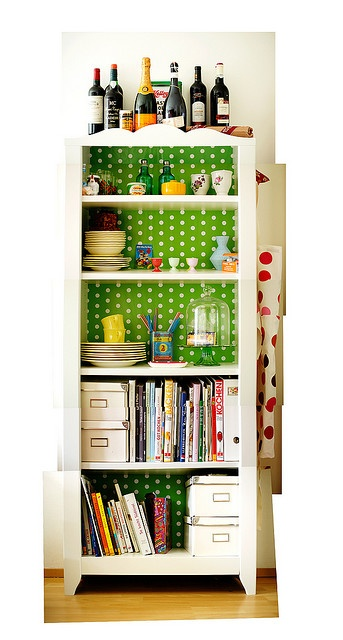 """Add some polka dots to the back of your bookshelf! I use the word """"books"""" lightly, a this one seems to hold everything, including a bar!"""