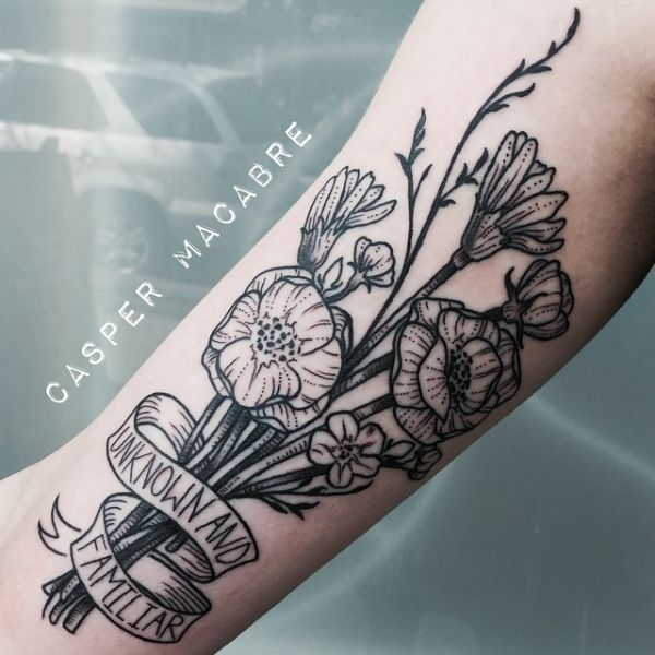 Traditional flower bouquet tattoo. Looks like it's got a carnation, a rose, maybe a crocus...