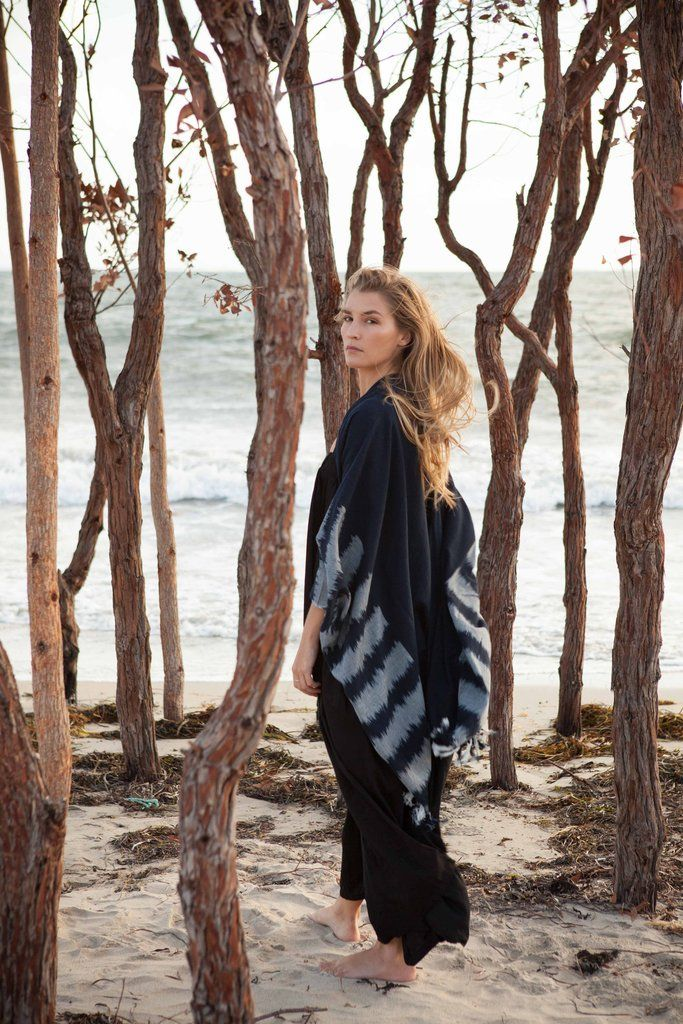 La Luna Handwoven Poncho A sophisticated piece that transitions easily through the places and spaces you need to be on any given day.  Made with 100% low impact dyed cotton, this piece comes from Ketzali Accessories who work closely with 36 men and women artisans in Guatemala to hand make each woven piece with care and traditional skills.    Every piece purchased supports and empowers the artisans to improve their living standards for their families and communities.