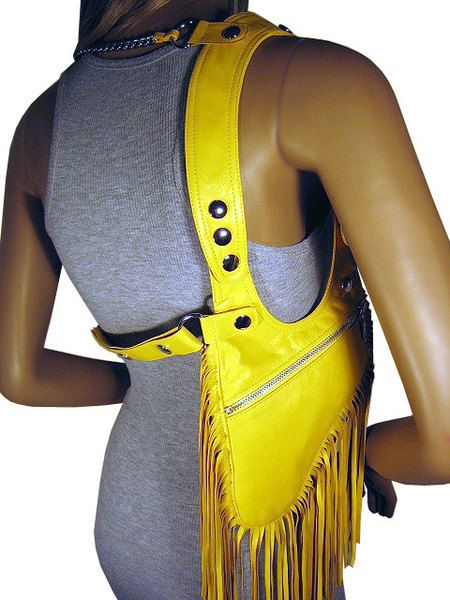 #Holster made of real, very soft lamb nappa leather in Sunshine #yellow with adjustable Halter  This bag has silver printer and approx 20 cm long fringes. Through simple te... #holster #revolverbag #limited #summer