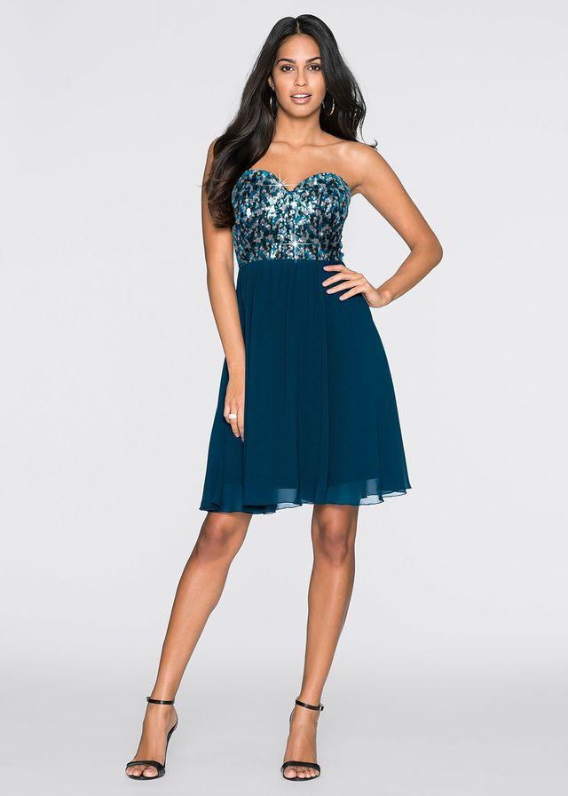 Piękna sukienka szyfonowa z cekinami w górnej części i dekoltem w kształcie serca. Rozkloszowana część spódnicowa. Dł. w rozm. 38 ok. 90 cm. Materiał wierzchni: 100% poliester; Podszewka: 100% poliester