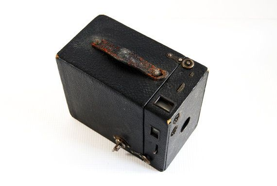 This beautiful vintage Kodak Brownie box camera is the perfect antique addition to your collection! Originally from the 1930s, this box camera is the model B, no. 2a camera. The strap on top of the box is broken, but it has so much character and life left! MEASUREMENTS: Height: 5 1/8