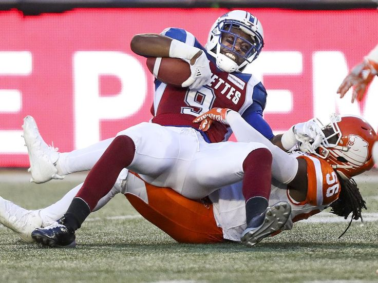 Week 3 - July 6 2017 - BC.23 - MTL.16 - Montreal Alouettes receiver Ernest Jackson lands on British Columbia Lions Solomon Elimimion after making a catch during first half of Canadian Football League game in Montreal Thursday July 6, 2017.  JOHN MAHONEY/MONTREAL GAZETTE