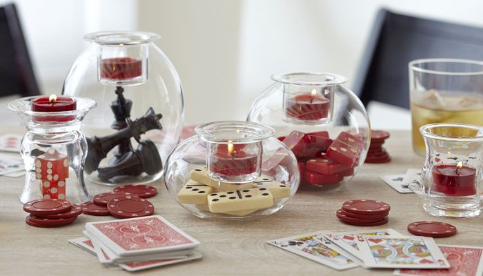 super creative! Store game pieces as home clever home decor in hand blown glass candle holders and vases by PartyLite