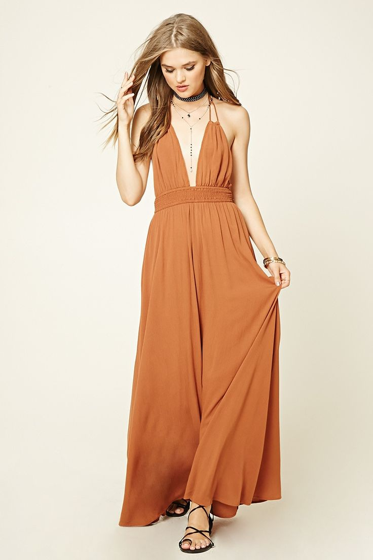 - A crinkled maxi dress featuring a tassled self-tie halter neckline, deep V-neckline, and a smocked waist.