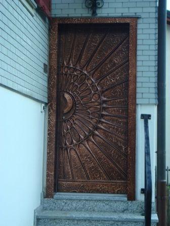 very cool door made of copper, Andermatt, Switzerland