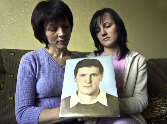 Natalya Lopatyuk, 41, left, and her daughter Yulia, 19, hold a portrait of Natalya's husband and Yulia's father Viktor in Kiev, Ukraine, Saturday, April 15, 2006. Viktor Lopatyuk, an electrician at the station died from acute radiation poisoning 22 days after the explosion at Chernobyl nuclear power plant.