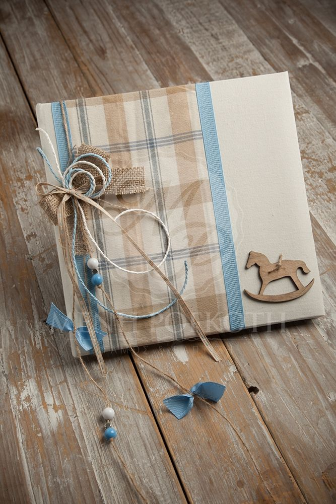 Ivory gauze guest book decorated with plaid ,burlap bow and wooden rocking horse