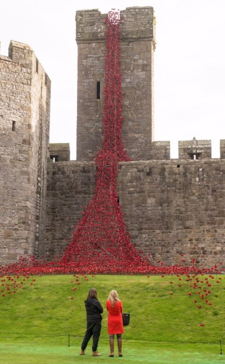 Caernarfon Castle - The venue is the first in Wales to host the sculpture as part of a UK-wide tour organised by 14-18 NOW, the UK's arts programme for the First World War centenary. - The Weeping Widow sculpture is made up of thousands of handmade ceramic poppies which were part of the Tower of London sculpture