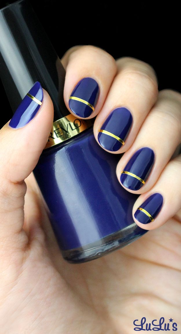 Indigo Blue and Gold Striped Nail | Love nail art? Follow http://www.pinterest.com/thevioletvixen/bold-nails/ for more!
