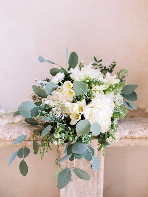 Elegant white wedding bouquet. Fine art wedding photography by Polly Alexandre.