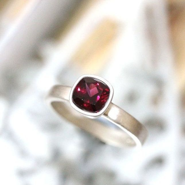 This gorgeous garnet piece is hand-set in a tapered sterling silver bezel made from genuine Argentium Silver, a recycled sterling silver.