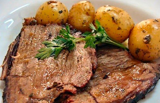 This Portuguese pot roast (carne assada) recipe, makes a sumptuous feast of beef with roast potatoes.