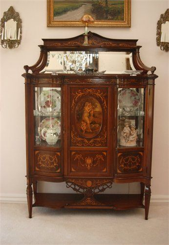 Victorian China Cabinet with inlaid detail, front has  rounded glass, with glass shelves and mirror backing.