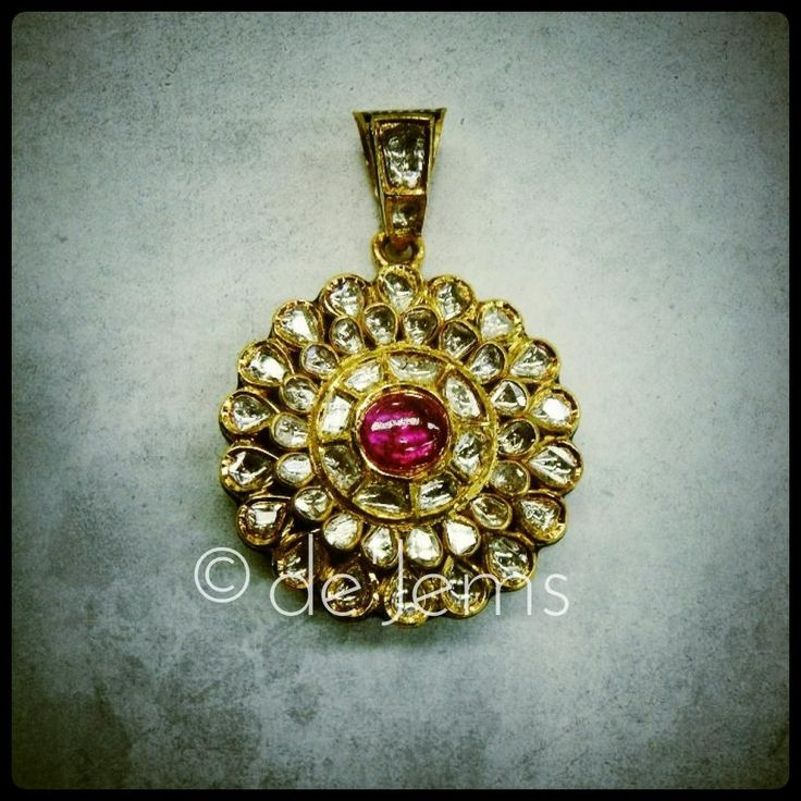 Jadau pendant, ft. uncut diamonds and a pink tourmaline, set in pure gold.