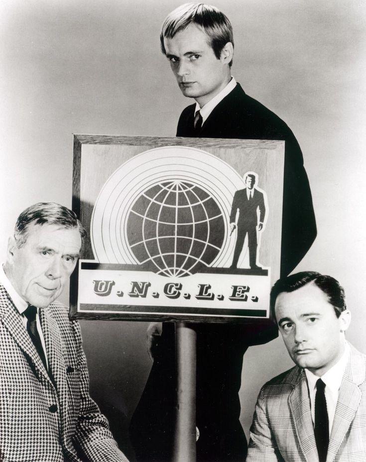 Leo G. Carroll (as Mr. Waverly), David McCallum (as Illya Kuriyakin), and Robert Vaughn (as Napoleon Solo), in THE MAN FROM U.N.C.L.E.
