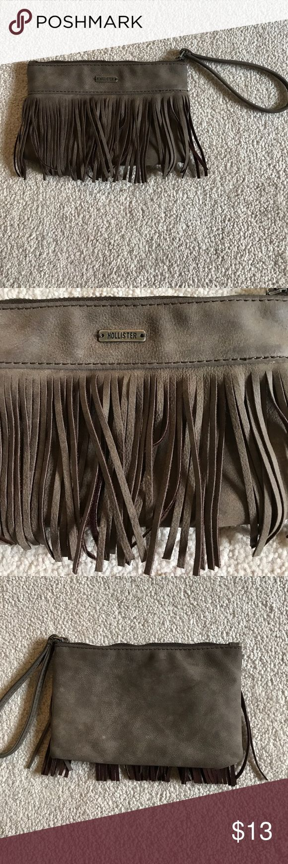 Hollister wristlet wallet This is a cute, brown/dark tan suede fringed wristlet purse/wallet from Hollister. Never used!! Perfect condition. Feel free to make an offer! Hollister Bags Clutches & Wristlets