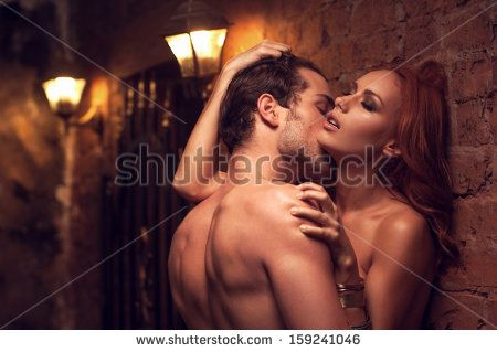 Beautiful couple having sex in gorgeous place. Man kissing woman�¢??s neck  - stock photo
