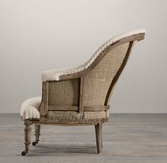 RH's Deconstructed French Napoleonic Chair:Inspired by the unadorned beauty of their grandfather's 19th-century wing chair – liberated from its velvet upholstery and the frame exposed – the Van Thiels replicated the Old World artistry in the French Napoleonic Chair. A distressed walnut frame, accented with nail tacks, is complemented by the texture of burlap and fabric. This is furniture for the ages.