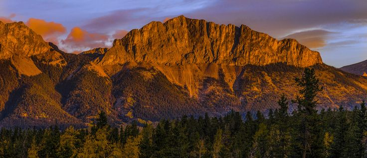 rocky mountain sunrise - sunrise near Banff Alberta. I waited for the sun to clear a ridge to illuminate this mountain near Banff, Alberta