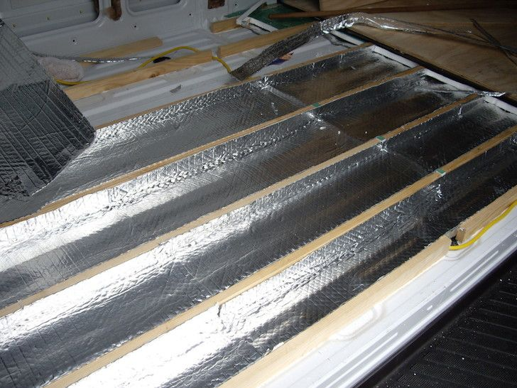 Mark used a lot of high-quality insulation in the build. He started by gluing foil-backed bubble wrap directly to the interior metal walls. This made a vapor barrier and prevented condensation from forming beneath the insulation.