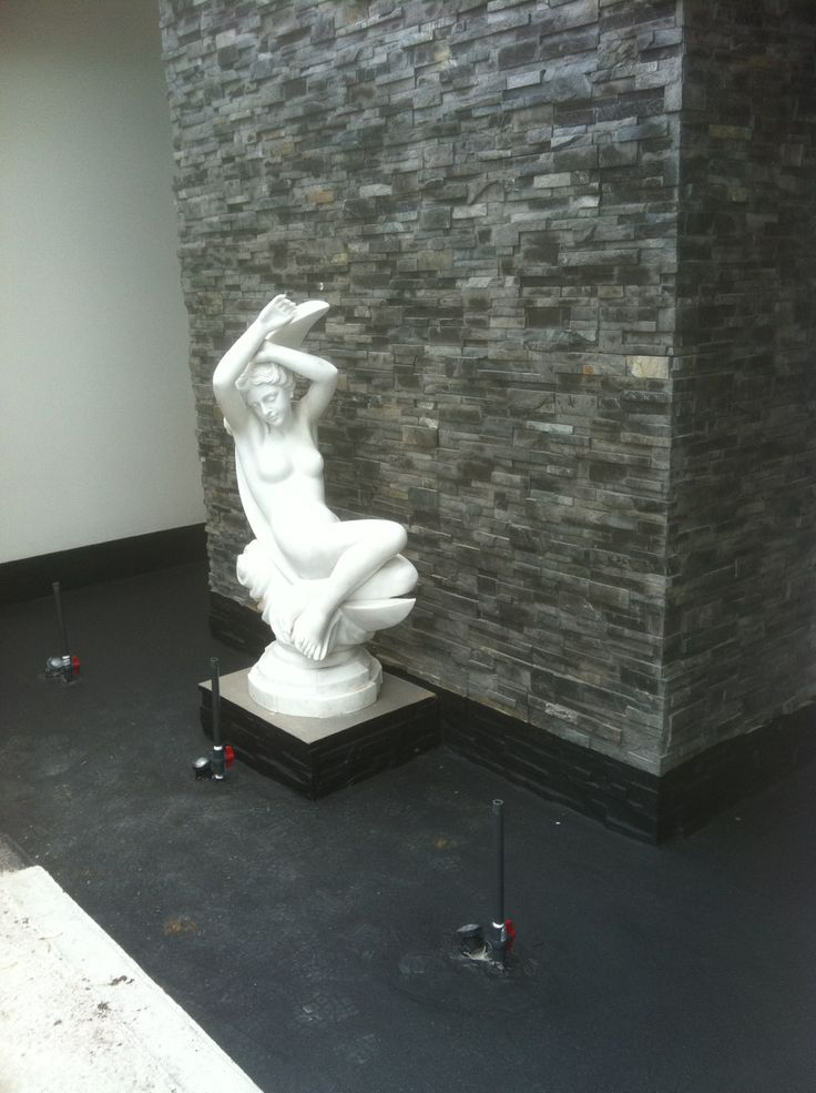 Water feature installation, waterproofing and lighting.