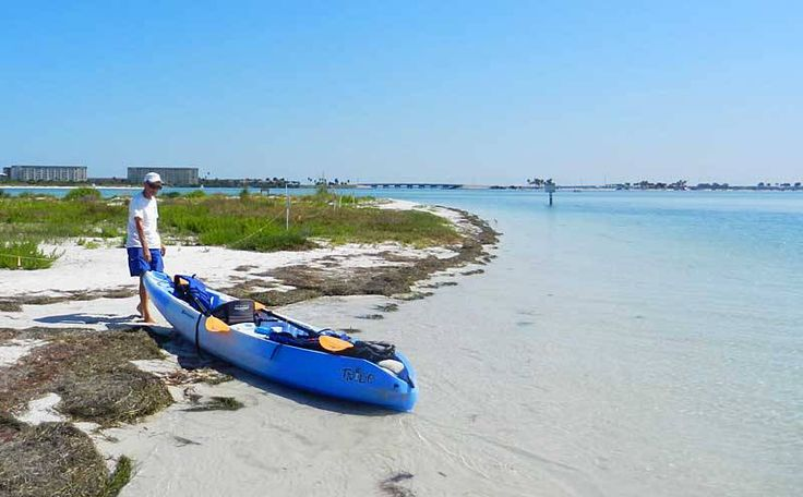 Caladesi Island State Park in Dunedin. Rent a kayak or take the $14 ferry