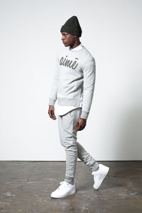 Shop this look on Lookastic:  https://lookastic.com/men/looks/crew-neck-sweater-long-sleeve-shirt-sweatpants-low-top-sneakers-beanie/11876  — Charcoal Beanie  — White Long Sleeve Shirt  — Grey Print Crew-neck Sweater  — Grey Sweatpants  — White Low Top Sneakers