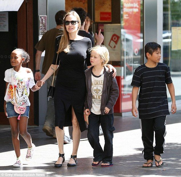 Family affair: Angelina Jolie take three of her children - Shiloh, Zahara and Pax - to a surfshop in Sydney.