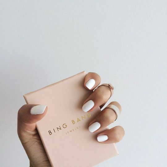 gold rings and white nails / manicure
