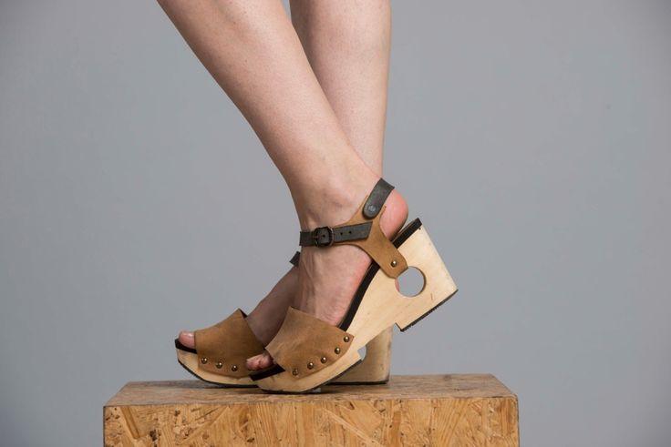 Handmade item                             Materials: Leather, Leather Lining, Wood Platform                                                          Ships worldwide from Tel Aviv, Israel