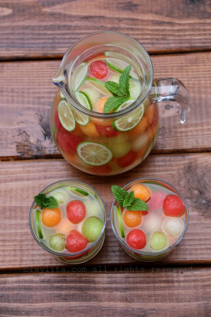 Summer melon moscato sangria. Ingredients ~3 cups of mixed melon balls (watermelon, cantaloupe, honeydew)  2-4 tablespoons of honey, adjust to taste  1 lime, juiced  ¼ cup to ½ cup of grappa, adjust to taste – can also use pisco or a clear grape brandy  1 bottle of moscato wine, chilled  ~ 1 ½ cups of sparkling water, chilled   To serve and garnish:  Mint leaves  Lime slices  Ice cubes or frozen melon ball ice cubes