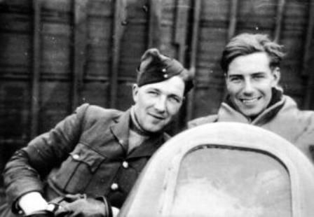 """P/O John F Drummond (left), camera in hand, poses with F/O Philip J """"Jack"""" Frost of No 46 Squadron RAF in the cockpit of Hurricane Mk I PO-N at Bardufoss, following combat with a Ju 87 over Harstad, photographed after landing at 15.40hrs on 2 June 1940. The windscreen was smashed by crossfire from the dive bomber."""