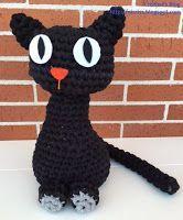 Cristina's Blog: Gato sujeta puertas a trapillo