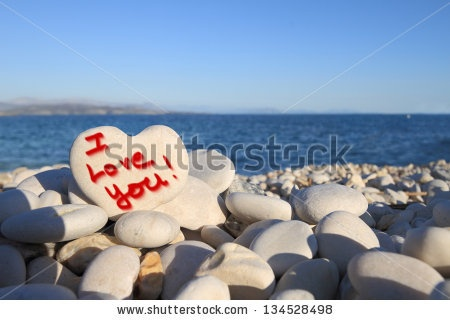 I Love you - written on heart shaped stone on the beach