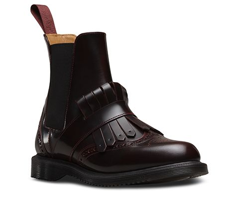 Fashion-forward and contemporary, the Tina Chelsea boot in two-tone Arcadia leather boasts brogue detailing, a kiltie strap and tassel, tonal heel loop and with inside gusset and side zip for ease of entry and a premium feel. Over-the-vamp strapping adds edgy detail, whilst a sleeker Goodyear welted outsole offers comfort and support. The bouncy AirWair sole is oil-and-fat-resistant, hard wearing and offers good abrasion and slip resistance.
