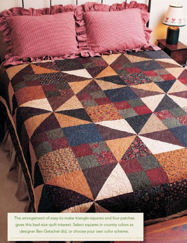 It's the arrangement of easy-to-make triangle squares and four patches that give this bed-size quilt interest.